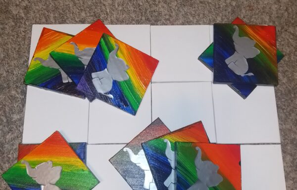 4×4 Rainbow Paintings with an Elephant in the Middle, by: Aurora Biggs